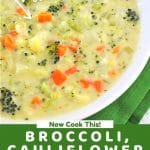 bowl of soup with a text overlay that says packed with veggies, now cook this, broccoli cauliflower and cheese soup