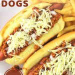 chili cheese dogs on a plate with french fries with a text overlay that says now cook this homemade chili cheese dogs, easy!