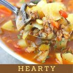 spoonful of soup over a bowl with a text overlay that says now cook this hearty hamburger soup