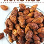 bowl of almonds with a text overlay that says smoky roasted almonds, nowcookthis.com
