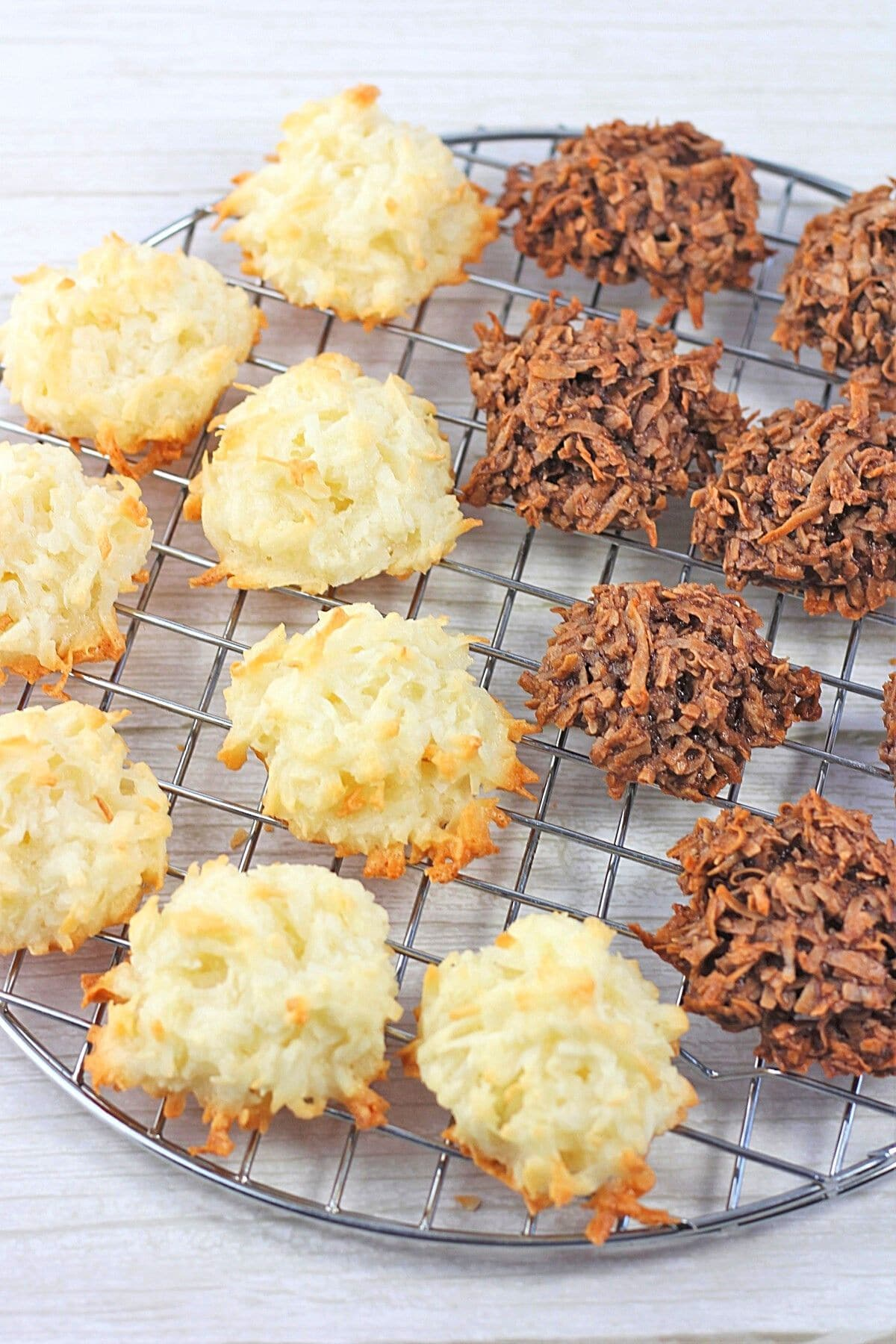 coconut macaroons and chocolate coconut macaroons on a wire cooling rack