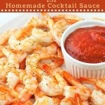 shrimp on a plate with cocktail sauce with a text overlay that says now cook this roasted shrimp cocktail with homemade cocktail sauce