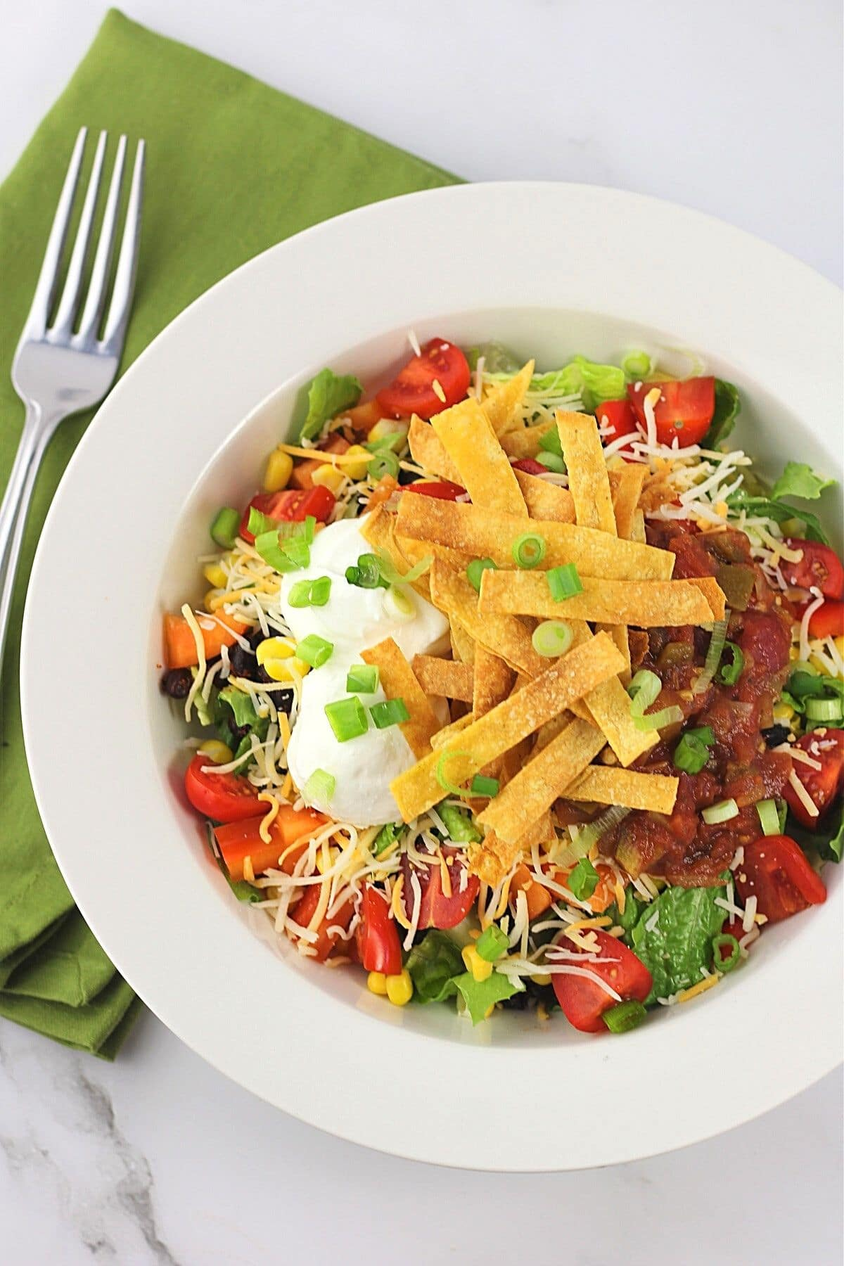 bowl of black bean taco salad with a fork and napkin