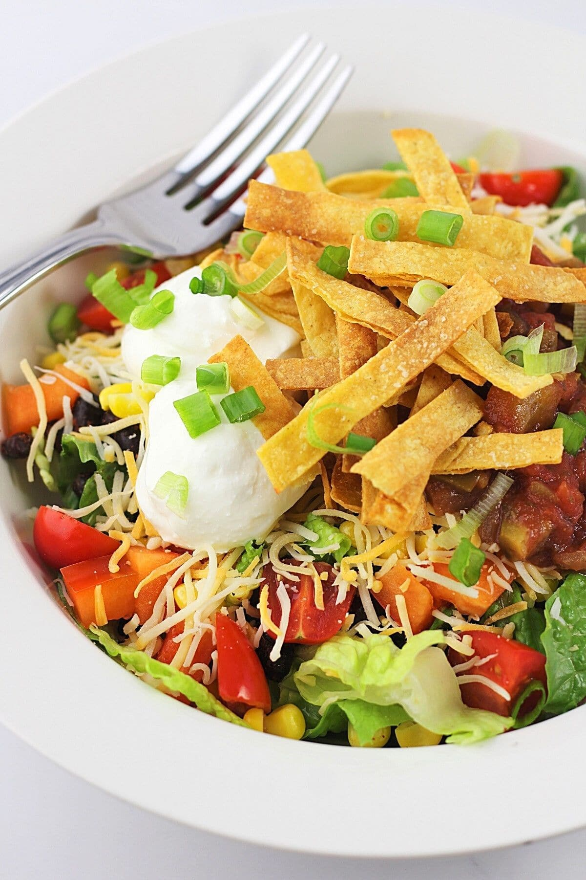 black bean taco salad in a bowl with a fork