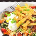 taco salad in a bowl with a text overlay that says now cook this, black bean taco salad, easy meatless meal