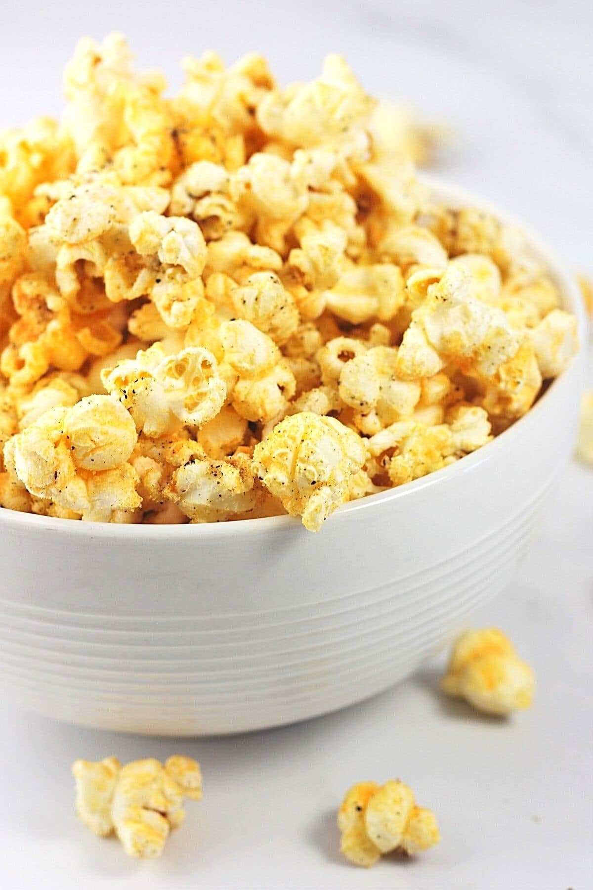 white bowl full of cheesy garlic pepper popcorn