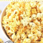 bowl of popcorn with a text overlay that says, cheesy garlic pepper popcorn, easy, nowcookthis.com