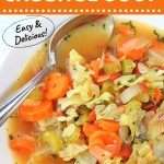 bowl of soup with a spoon with a text overlay that says now cook this, low-calorie cabbage soup, easy and delicious