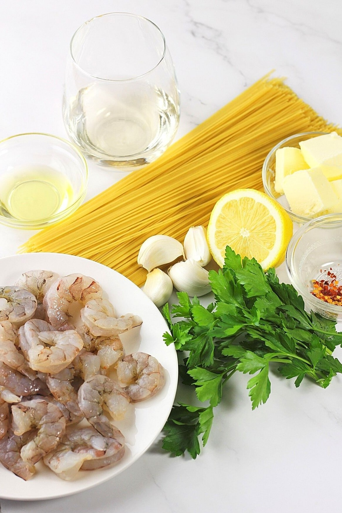 image of the ingredients needed to make shrimp scampi with angel hair pasta