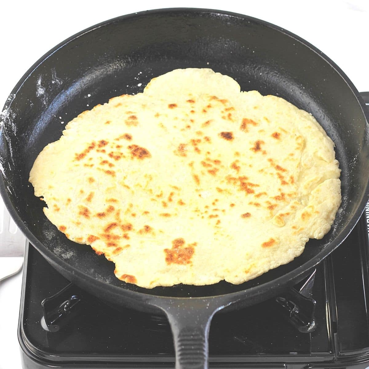 cooked flatbread in a cast iron skillet