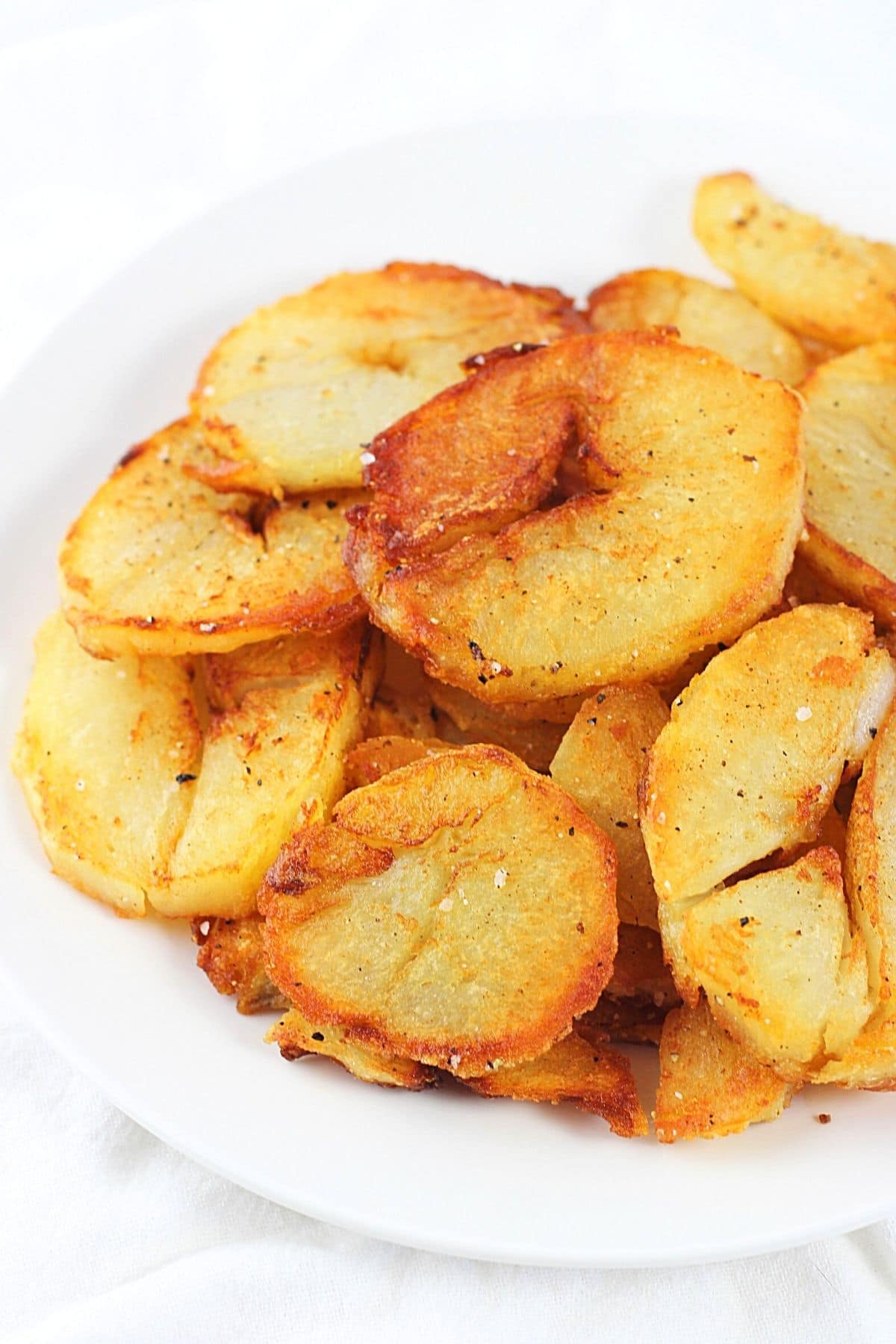 leftover baked potato home fries on a white plate