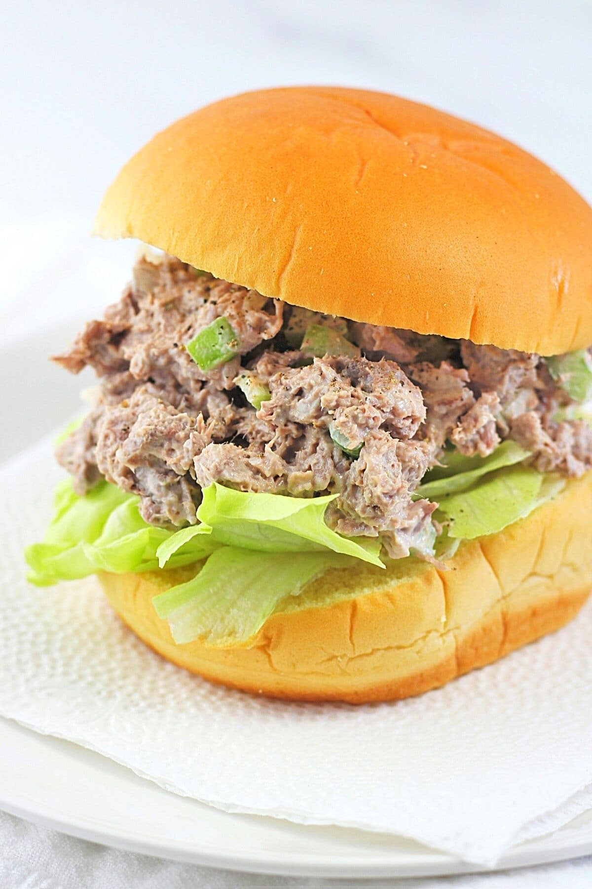 roast beef salad sandwich spread on a bun with lettuce