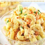 bowl of macaroni salad with text overlays that say now cook this, classic creamy macaroni salad, and get the recipe