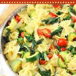 bowtie pasta and vegetables in a pan with text overlays that say now cook this, farfalle pasta with zucchini, spinach and tomatoes, and get the recipe