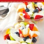 two bowls of fruit salad topped with yogurt dressing with text overlays that say now cook this, fruit salad with creamy vanilla yogurt dressing, and get the recipe