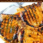 grilled pork chops on a plate with a serving fork with text overlays that say now cook this, honey mustard grilled pork chops, and get the recipe