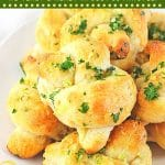 garlic knots piled on a plate with text overlays that say not cook this, quick and easy garlic knots, no yeast and ready in just 30 minutes, and get the recipe