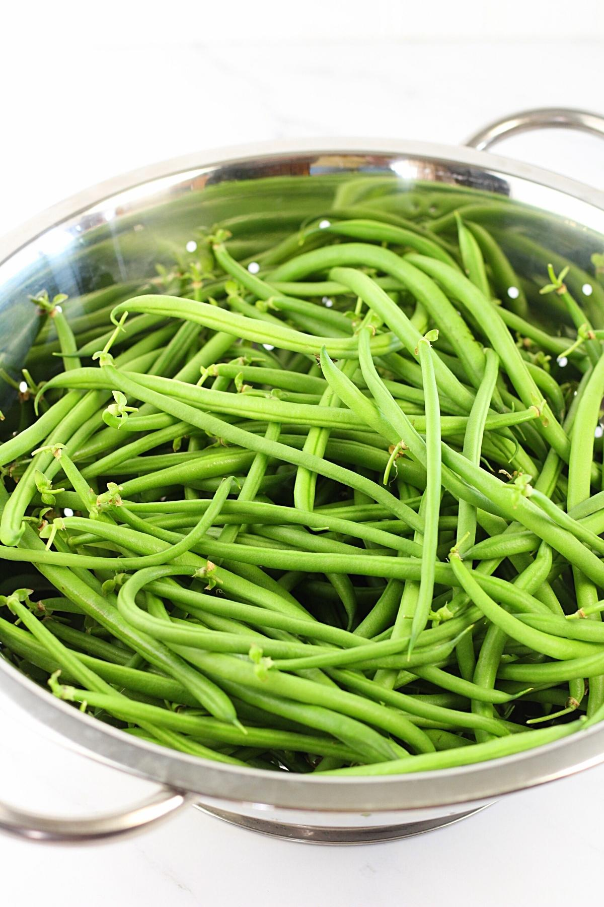 fresh picked green beans in a colander
