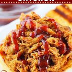 shredded barbecue chicken on a bun with barbecue sauce with text overlays that say now cook this, slow cooker bbq pulled chicken, and get the easy recipe