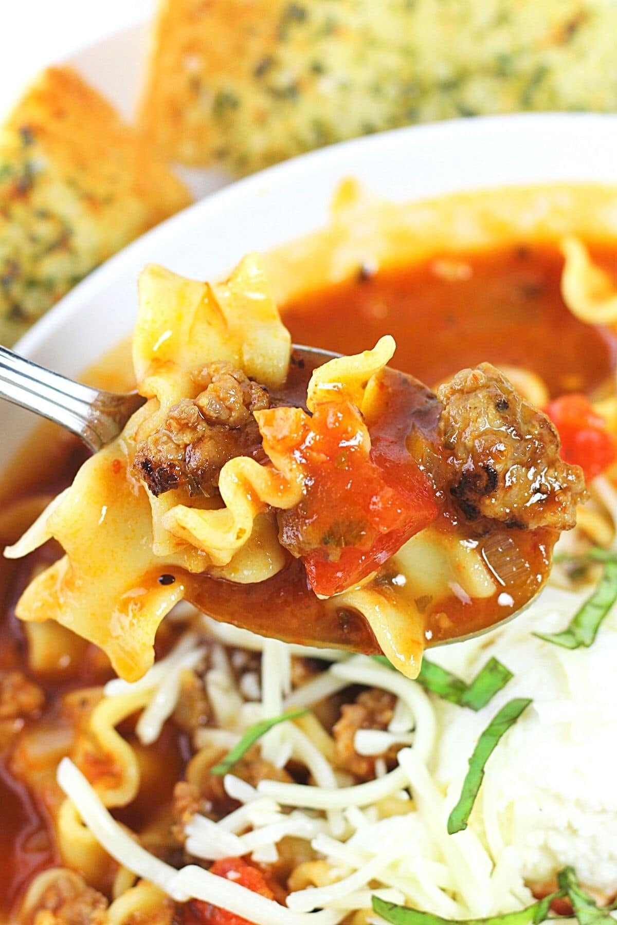close-up of a spoonful of easy lasagna soup being taken out of the bowl