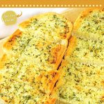 garlic bread on a cutting board with text overlays that say now cook this, homemade garlic bread, and get the recipe